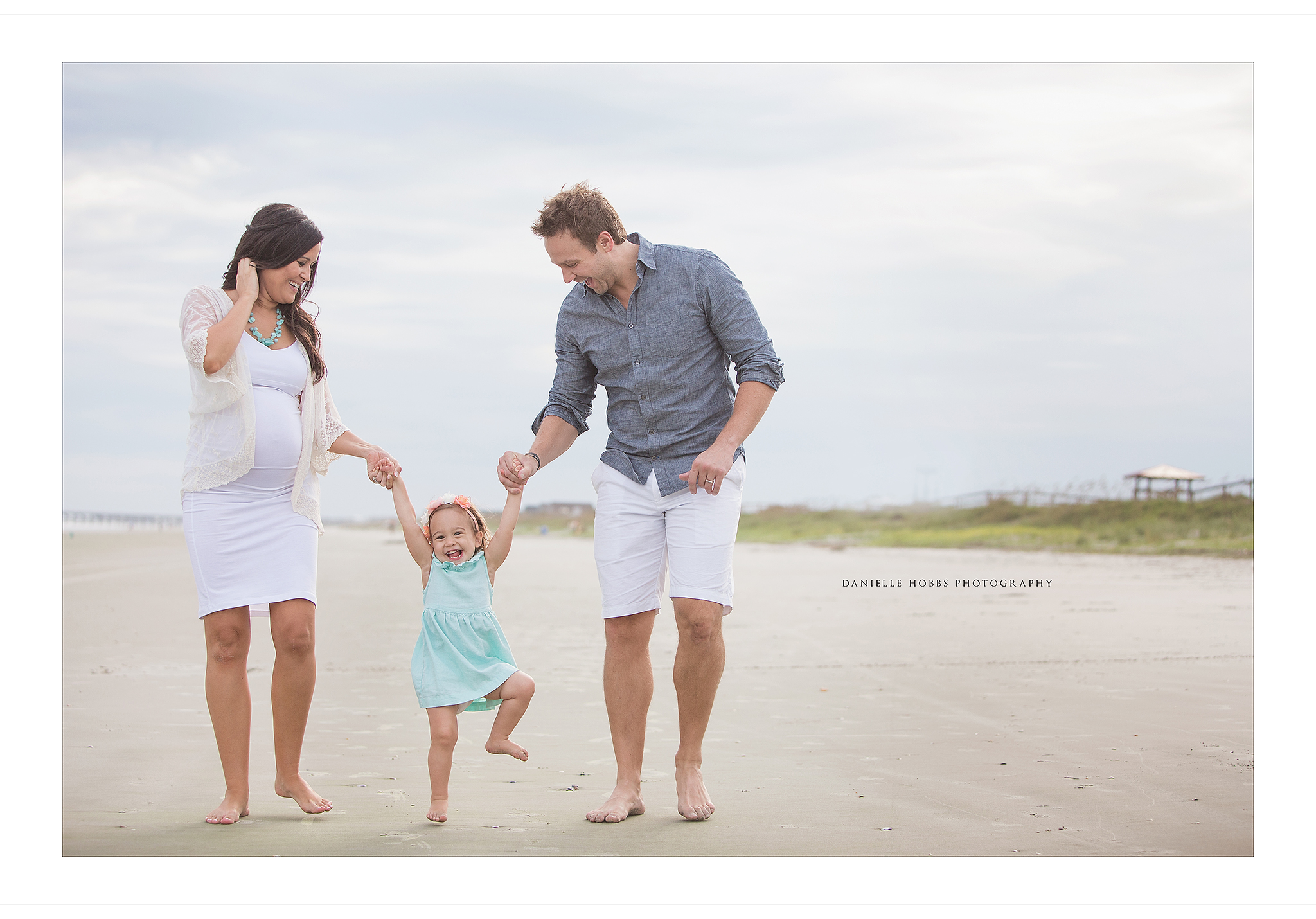 Family maternity session at the beach