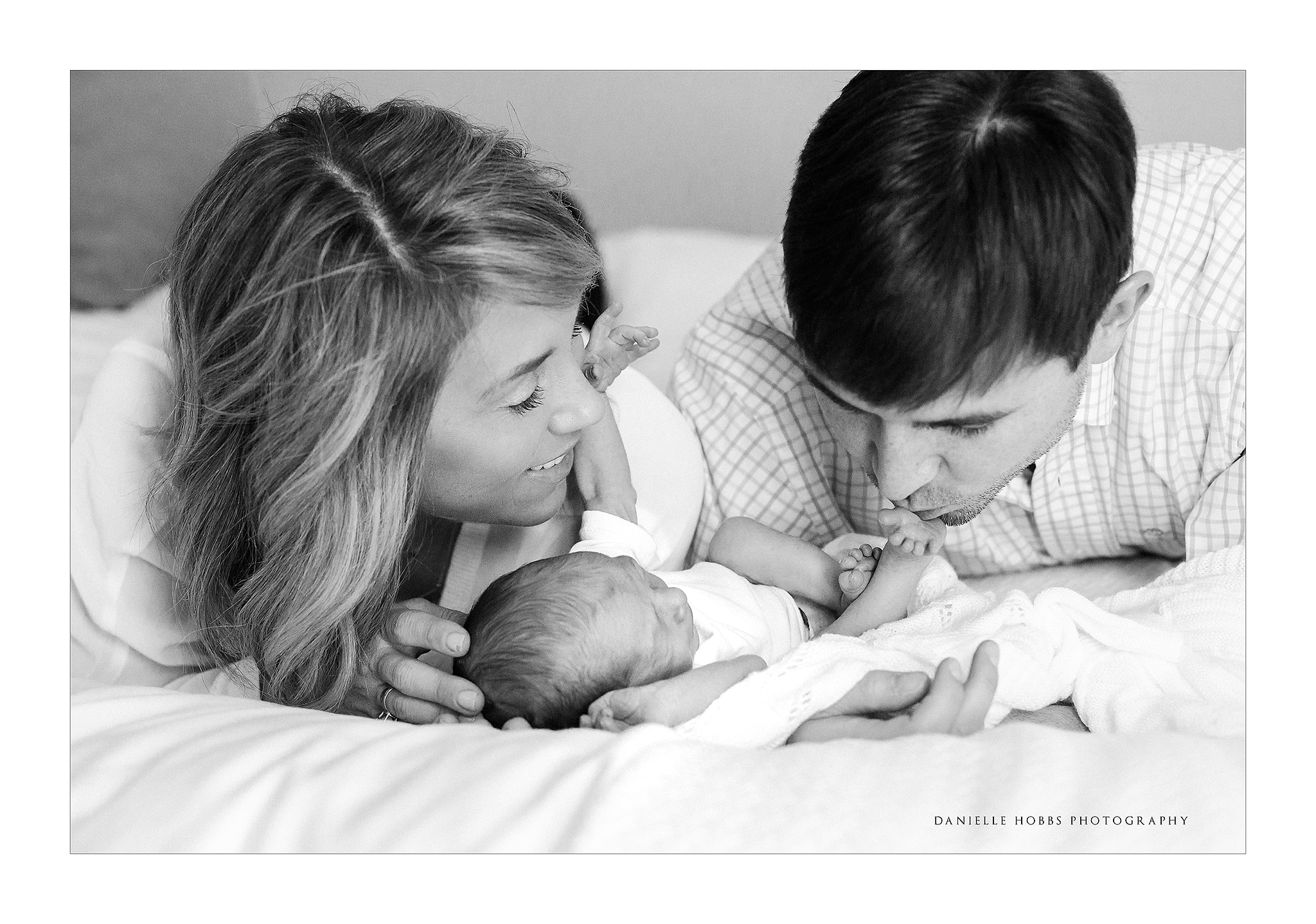 Dad kissing baby toes DC Newborn