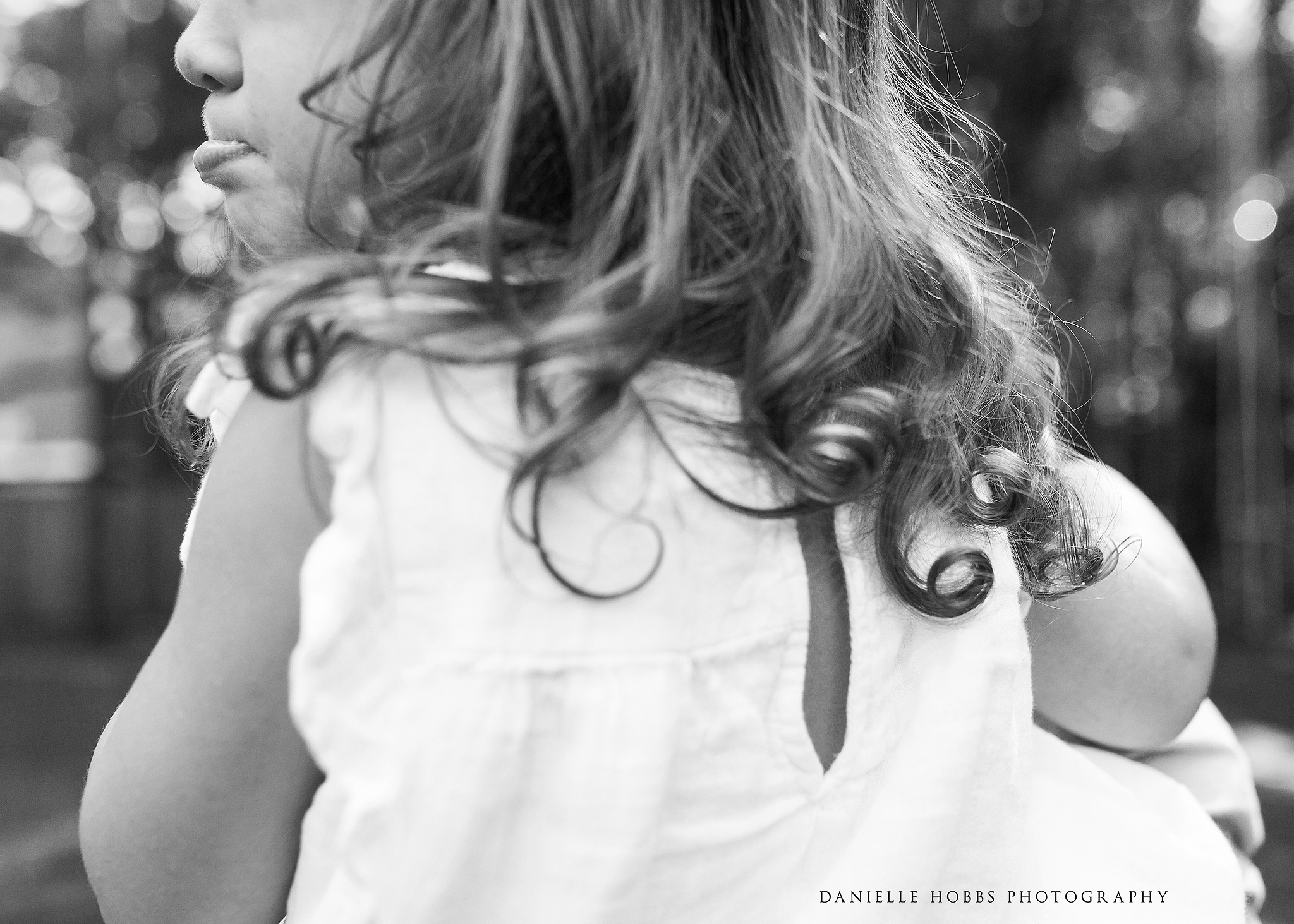 Toddler curls and pouty lip black and white family photography